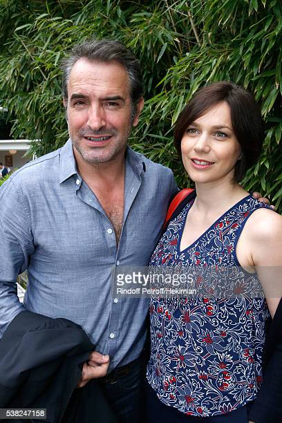 Actor Jean Dujardin and Nathalie Pechalat attend Day Fifteen Men single's Final of the 2016 French Tennis Open at Roland Garros on June 5 2016 in...