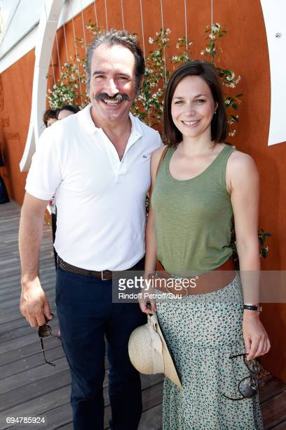 Actor Jean Dujardin and Nathalie Pechalat attend the Men Final of the 2017 French Tennis Open Day Fithteen at Roland Garros on June 11 2017 in Paris...