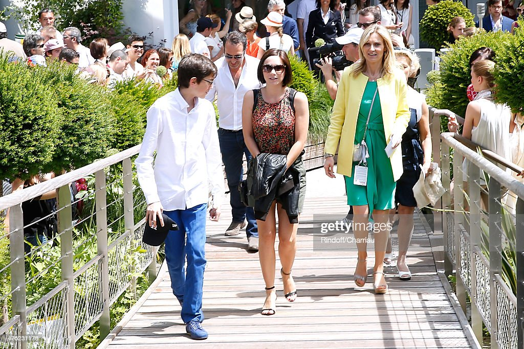 Actor Jean Dujardin and Skater Nathalie Pechalat attend the Men Final of 2015 Roland Garros French Tennis Open Day Fithteen on June 7 2015 in Paris...