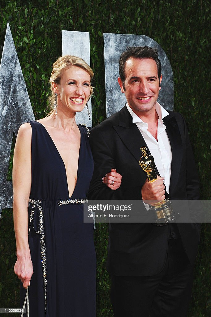 Actor Jean Dujardin (R) and wife Alexandra Lamy arrives at the 2012 Vanity Fair Oscar Party hosted by Graydon Carter at Sunset Tower on February 26, 2012 in West Hollywood, California.