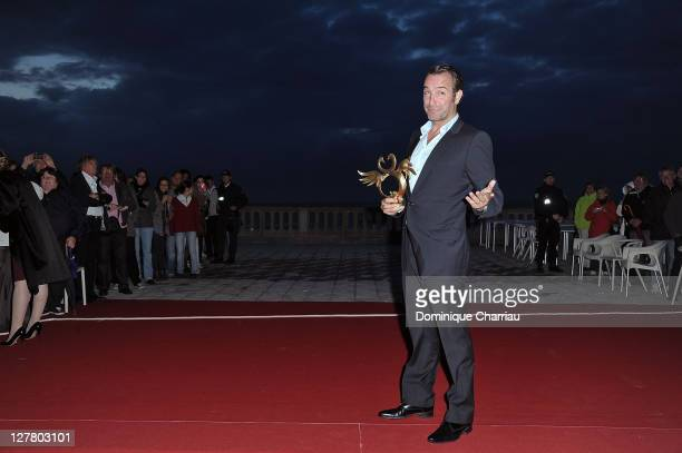 Actor Jean Dujardin Awarded 'Cigne d'or' for best actor during 25th Cabourg Film Festival on June 18 2011 in Cabourg France
