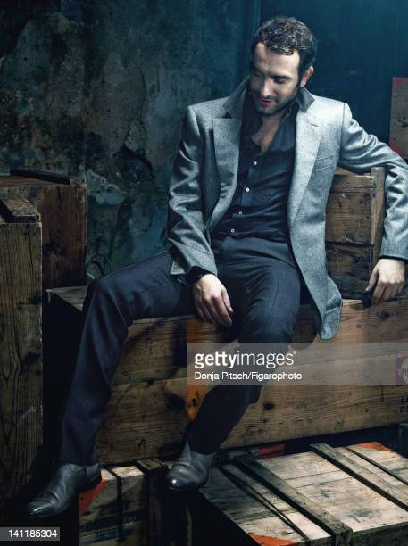Actor Jean Dujardin is photographed for Madame Figaro on December 12 2007 in Paris France Figaro ID 078899005 Jacket and pants by Smalto shirt by...