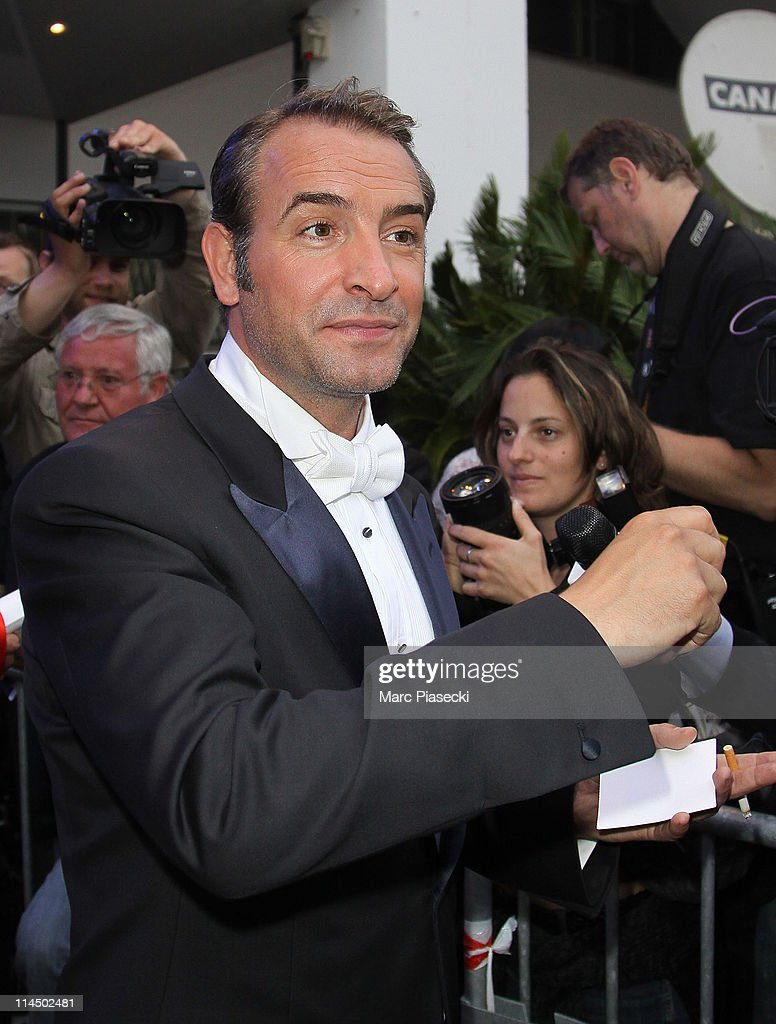 Actor <a gi-track='captionPersonalityLinkClicked' href=/galleries/search?phrase=Jean+Dujardin&family=editorial&specificpeople=620972 ng-click='$event.stopPropagation()'>Jean Dujardin</a> is sighting leaving the 'Palais des Festivals' after the 'Palme d'Or' ceremony on May 22, 2011 in Cannes, France.