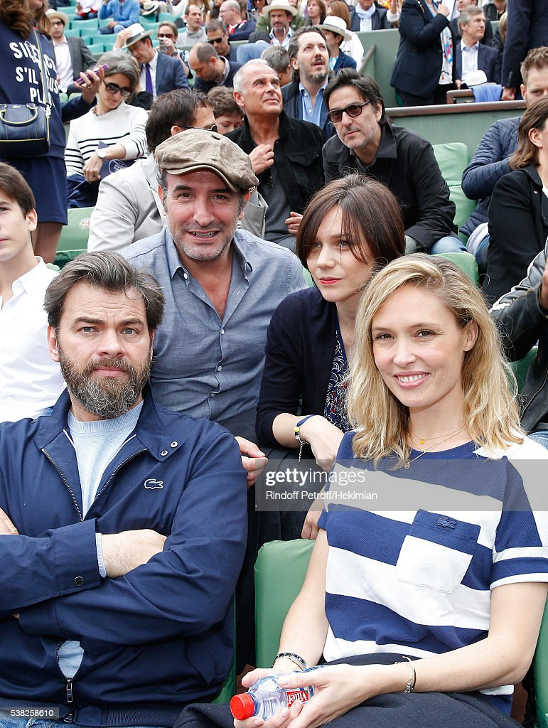 Actor Jean Dujardin, Nathalie Pechalat, actors Clovis Cornillac and his wife Lilou Fogli attend Day Fifteen, Men single's Final of the 2016 French Tennis Open at Roland Garros on June 5, 2016 in Paris, France.