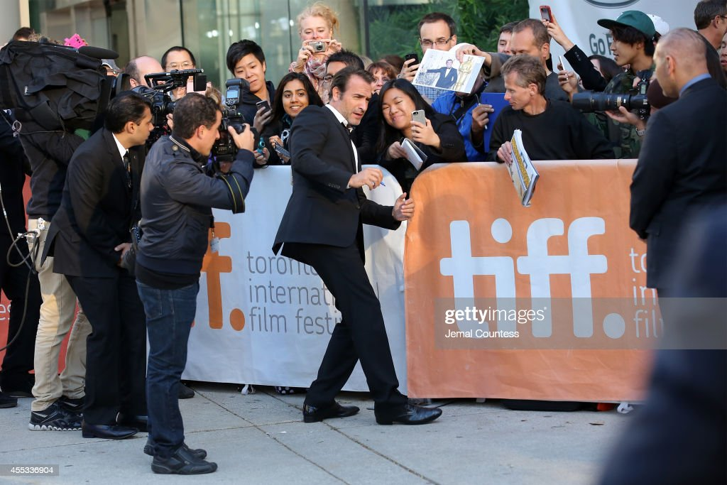 Actor Jean Dujardin poses for a selfie with a fan as he attends 'The Connection' premiere during the 2014 Toronto International Film Festival at Roy...