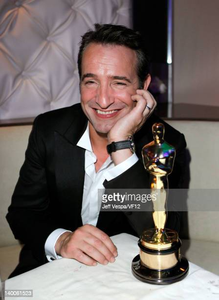 Actor Jean Dujardin poses with his award for Best Actor for 'The Artist' at the 2012 Vanity Fair Oscar Party Hosted By Graydon Carter at Sunset Tower...