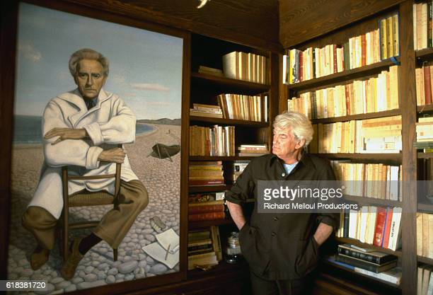 Actor Jean Marais stands next to a painting of Jean Cocteau at his home in Vallauris France Marais and Cocteau were closely associated throughout...
