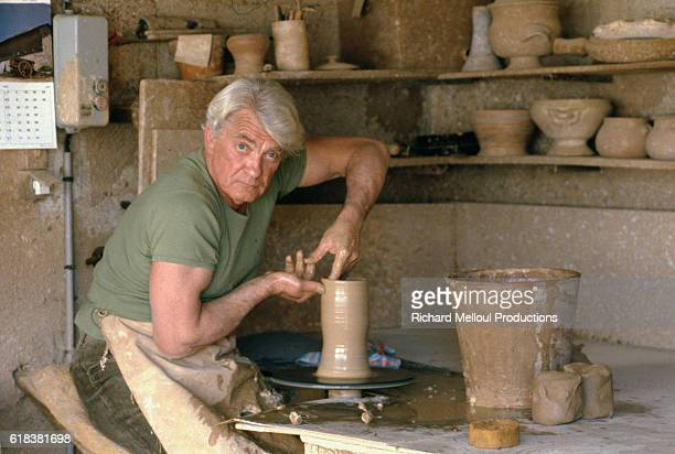 Actor Jean Marais works on a piece of pottery at his home in Vallauris France