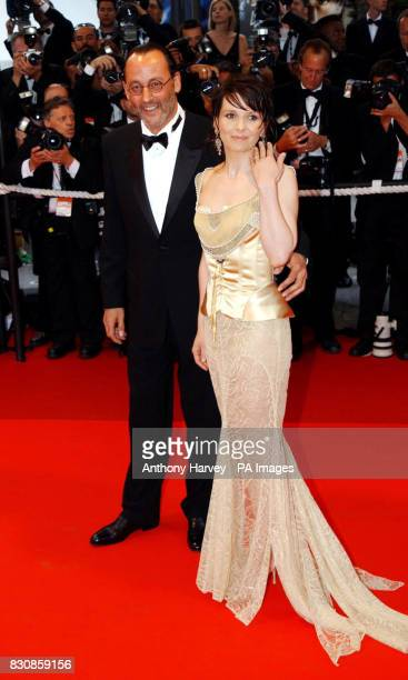 Actor Jean Reno and Juliet Binoche arrive at the Premiere of 'PunchDrunk Love' at the Palais des Festival during the 55th Cannes Film Festival