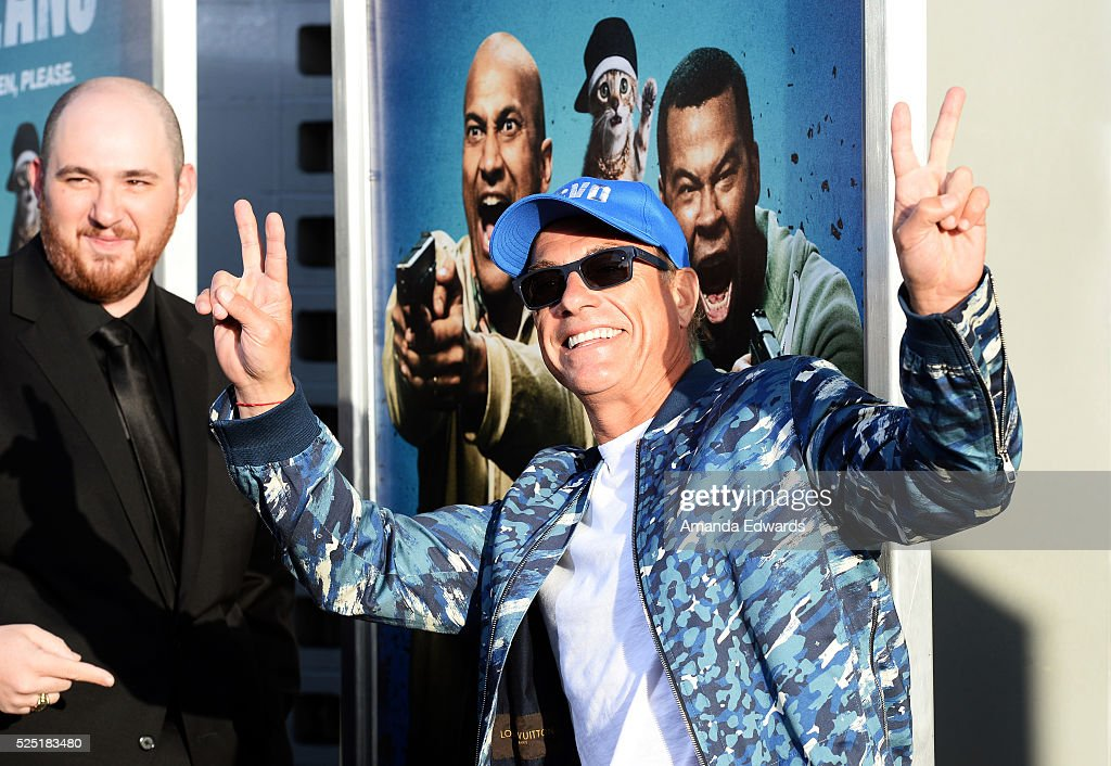 Actor <a gi-track='captionPersonalityLinkClicked' href=/galleries/search?phrase=Jean-Claude+Van+Damme&family=editorial&specificpeople=566465 ng-click='$event.stopPropagation()'>Jean-Claude Van Damme</a> (R) and director Peter Atencio arrive at the premiere of Warner Bros.' 'Keanu' at the ArcLight Cinemas Cinerama Dome on April 27, 2016 in Hollywood, California.