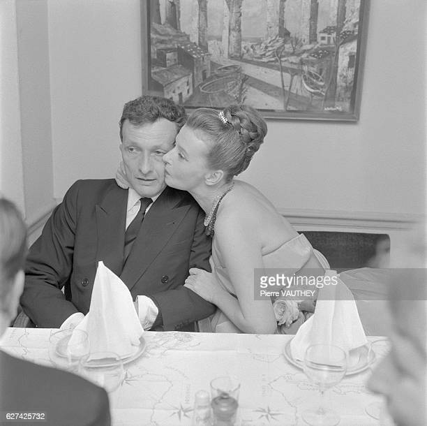 Actor JeanLouis Barrault receives a kiss from his niece MarieChristine Barrault at a dinner in Paris