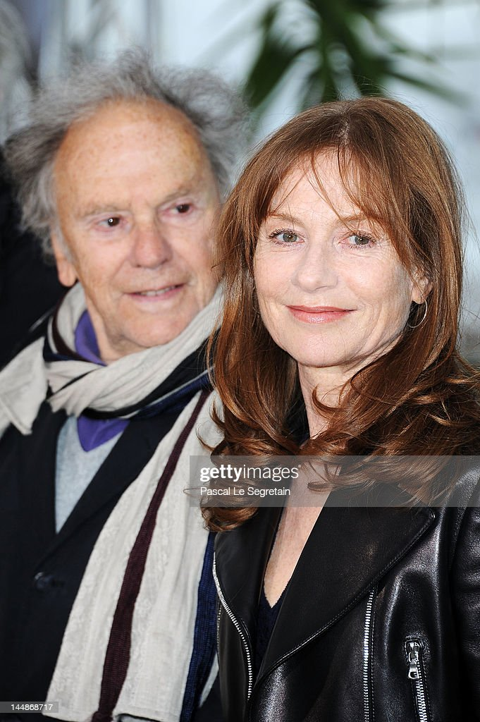 Actor <a gi-track='captionPersonalityLinkClicked' href=/galleries/search?phrase=Jean-Louis+Trintignant&family=editorial&specificpeople=1822183 ng-click='$event.stopPropagation()'>Jean-Louis Trintignant</a> and actress <a gi-track='captionPersonalityLinkClicked' href=/galleries/search?phrase=Isabelle+Huppert&family=editorial&specificpeople=662796 ng-click='$event.stopPropagation()'>Isabelle Huppert</a> pose at the 'Amour' Photocall during the 65th Annual Cannes Film Festival at Palais des Festivals on May 20, 2012 in Cannes, France.