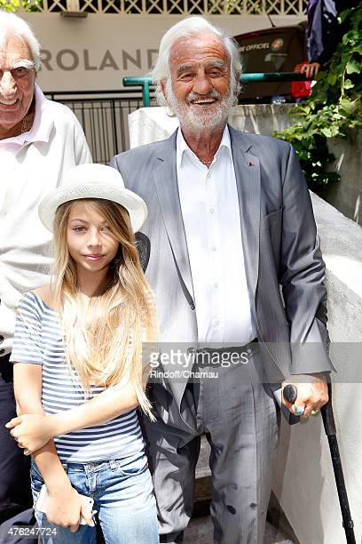 Actor JeanPaul Belmondo with his daughter Stella Belmondo attend the Men Final of 2015 Roland Garros French Tennis Open Day Fithteen on June 7 2015...