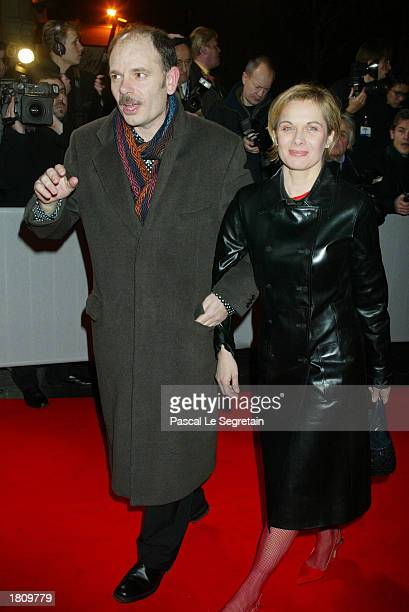 Actor JeanPierre Daroussin and his wife arrive at the Cesars film awards February 22 2003 at the Theatre du Chatelet in Paris France