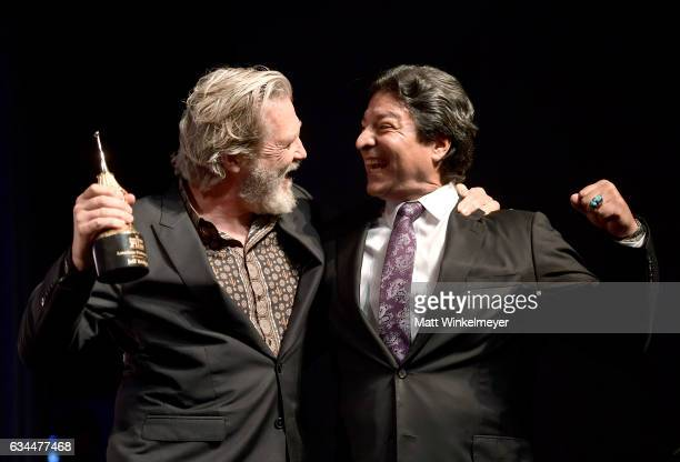Actor Jeff Bridges accepts the American Riviera Award from actor Gil Birmingham onstage at the Arlington Theatre on February 9 2017 in Santa Barbara...