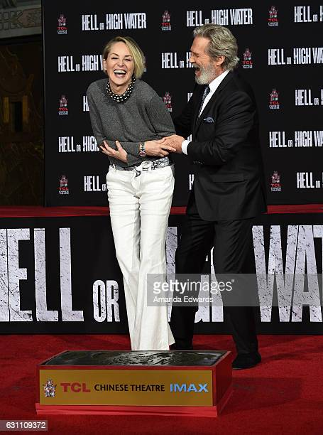 Actor Jeff Bridges and actress Sharon Stone attend Bridges' hand and footprint ceremony at the TCL Chinese 6 Theatres on January 6 2017 in Hollywood...