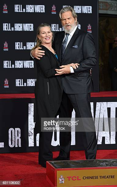 Actor Jeff Bridges stands with his wife Susan Geston during his Hand and Footprint Ceremony at the TCL Chinese Theater in Hollywood California on...