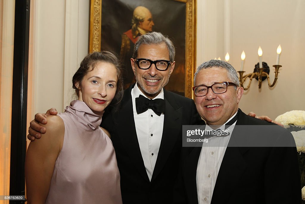 Actor Jeff Goldblum, center, and Emilie Livingston, left, attend the Bloomberg Vanity Fair White House Correspondents' Association (WHCA) dinner afterparty in Washington, D.C., U.S., on Saturday, April 30, 2016. The 102nd WHCA raises money for scholarships and honors the recipients of the organization's journalism awards. Photographer: Andrew Harrer/Bloomberg via Getty Images