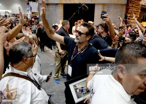 Actor Jeffrey Dean Morgan from 'The Walking Dead' signs autographs and takes photos with fans at San Diego ComicCon International 2017 at the San...
