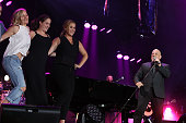 Actor Jennifer Lawrence Kim Caramele and Amy Schumer join musician Billy Joel on stage for the encore of his sold out concert at Wrigley Field on...