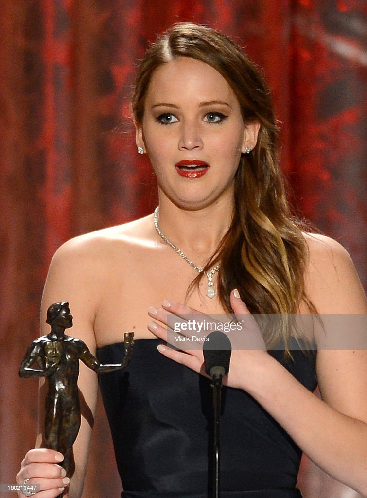 Actor <a gi-track='captionPersonalityLinkClicked' href=/galleries/search?phrase=Jennifer+Lawrence&family=editorial&specificpeople=1596040 ng-click='$event.stopPropagation()'>Jennifer Lawrence</a> speaks onstage during the 19th Annual Screen Actors Guild Awards held at The Shrine Auditorium on January 27, 2013 in Los Angeles, California.