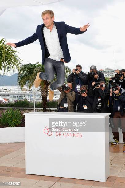 Actor Jeremie Renier poses during the 'Elefante Blanco' Photocall during 65th Annual Cannes Film Festival at Palais des Festivals on May 21 2012 in...