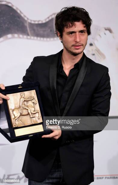 Actor Jeremy Elkaim with his Best Actor award for 'Main dans la main' at the Award Winners Photocall during the 7th Rome Film Festival at Auditorium...