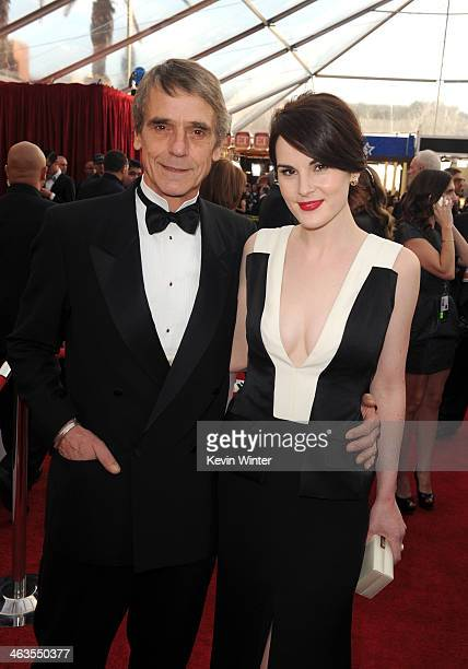 Actor Jeremy Irons and actress Michelle Dockery attend 20th Annual Screen Actors Guild Awards at The Shrine Auditorium on January 18 2014 in Los...