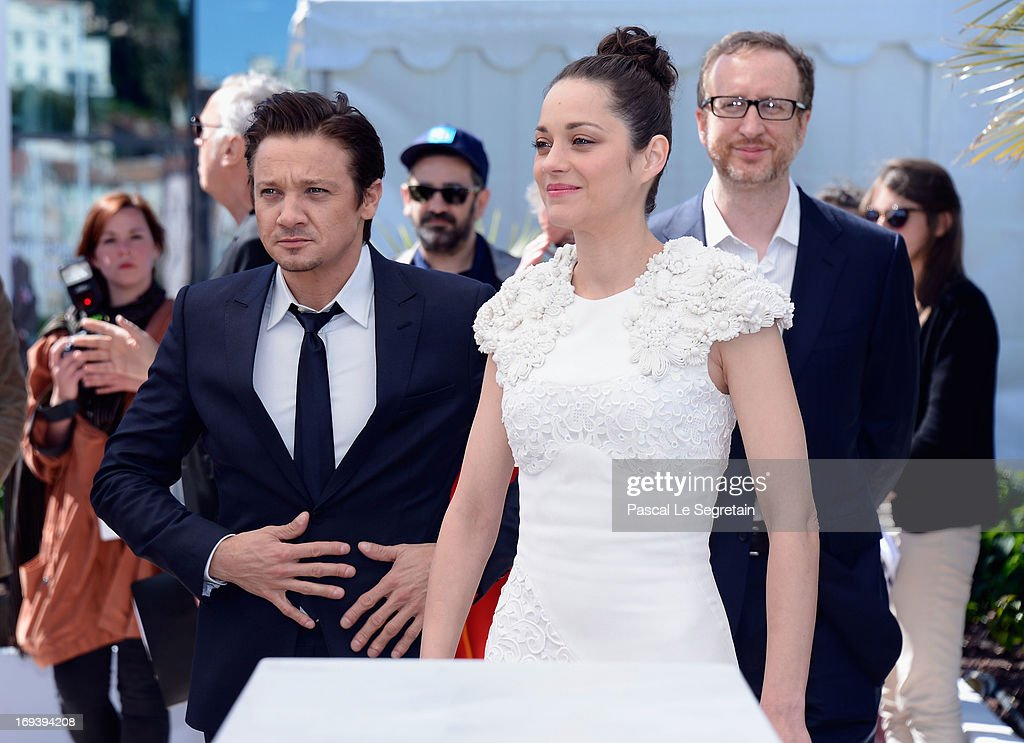 Actor <a gi-track='captionPersonalityLinkClicked' href=/galleries/search?phrase=Jeremy+Renner&family=editorial&specificpeople=708701 ng-click='$event.stopPropagation()'>Jeremy Renner</a>, actress <a gi-track='captionPersonalityLinkClicked' href=/galleries/search?phrase=Marion+Cotillard&family=editorial&specificpeople=215303 ng-click='$event.stopPropagation()'>Marion Cotillard</a> and director <a gi-track='captionPersonalityLinkClicked' href=/galleries/search?phrase=James+Gray&family=editorial&specificpeople=2479723 ng-click='$event.stopPropagation()'>James Gray</a> attend 'The Immigrant' photocall during The 66th Annual Cannes Film Festival at he Palais des Festivals on May 24, 2013 in Cannes, France.