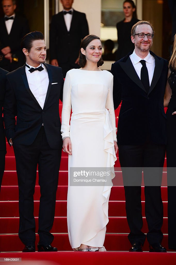 Actor Jeremy Renner, actress Marion Cotillard and director James Gray attend the Premiere of 'The Immigrant' at The 66th Annual Cannes Film Festival at Palais des Festivals on May 24, 2013 in Cannes, France.
