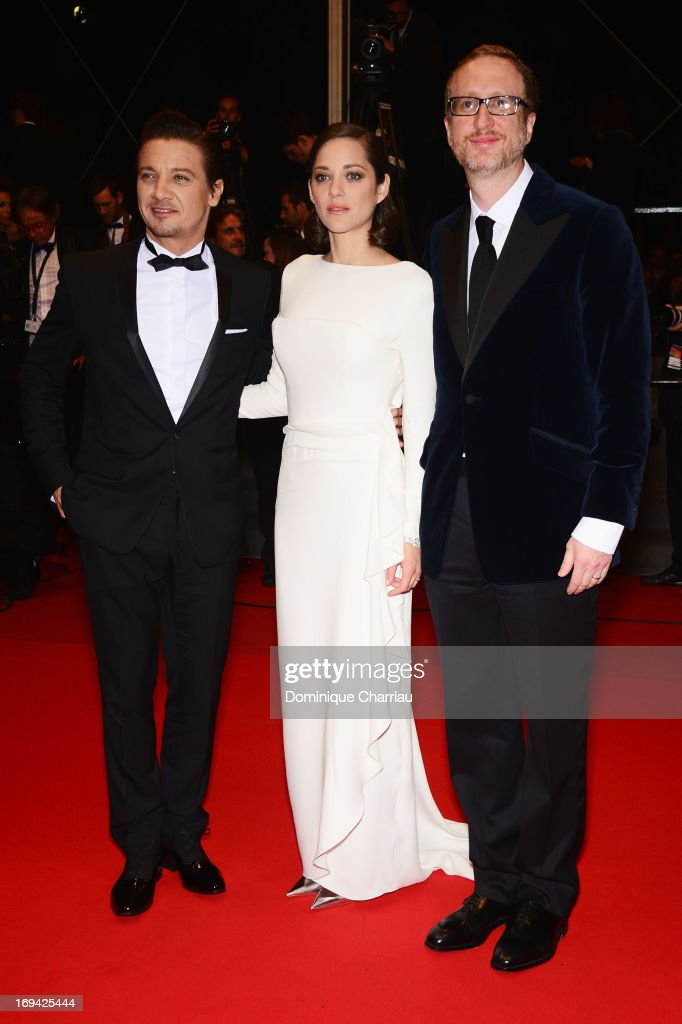 Actor Jeremy Renner, actress Marion Cotillard and director James Gray depart the Premiere of 'The Immigrant' at The 66th Annual Cannes Film Festival at Palais des Festivals on May 24, 2013 in Cannes, France.