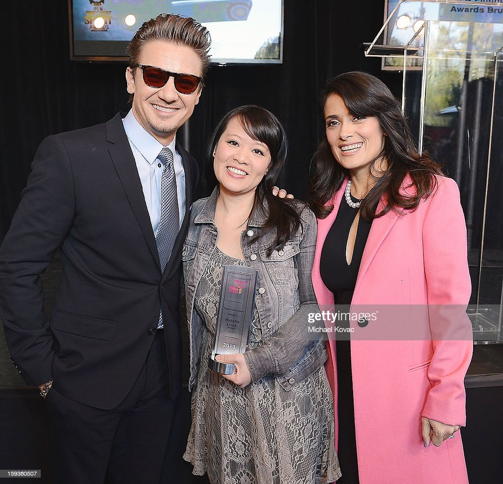 Actor <a gi-track='captionPersonalityLinkClicked' href=/galleries/search?phrase=Jeremy+Renner&family=editorial&specificpeople=708701 ng-click='$event.stopPropagation()'>Jeremy Renner</a> (L) and actress <a gi-track='captionPersonalityLinkClicked' href=/galleries/search?phrase=Salma+Hayek&family=editorial&specificpeople=201844 ng-click='$event.stopPropagation()'>Salma Hayek</a> (R) pose with Piaget Producers Award winner Mynette Louie (C) at the 2013 Film Independent Filmmaker Grant And Spirit Awards Nominees Brunch at BOA Steakhouse on January 12, 2013 in West Hollywood, California.