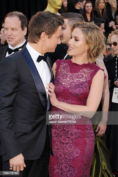 Actor Jeremy Renner and actress Scarlett Johansson arrives at the 83rd Annual Academy Awards held at the Kodak Theatre on February 27 2011 in...