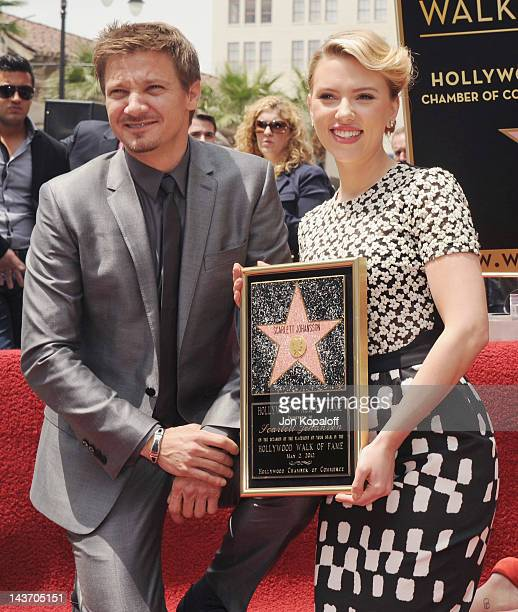 Actor Jeremy Renner and actress Scarlett Johansson pose at Scarlett Johansson Honored With The Star On The Hollywood Walk Of Fame on May 2 2012 in...