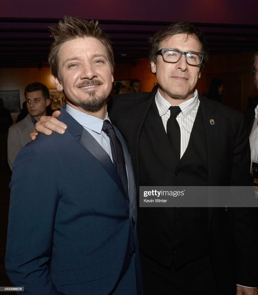 Actor <a gi-track='captionPersonalityLinkClicked' href=/galleries/search?phrase=Jeremy+Renner&family=editorial&specificpeople=708701 ng-click='$event.stopPropagation()'>Jeremy Renner</a> (L) and director/screenwriter <a gi-track='captionPersonalityLinkClicked' href=/galleries/search?phrase=David+O.+Russell&family=editorial&specificpeople=215306 ng-click='$event.stopPropagation()'>David O. Russell</a> attend Columbia Pictures And Annapurna Pictures' 'American Hustle' Special Screening at Directors Guild Of America on December 3, 2013 in Los Angeles, California.