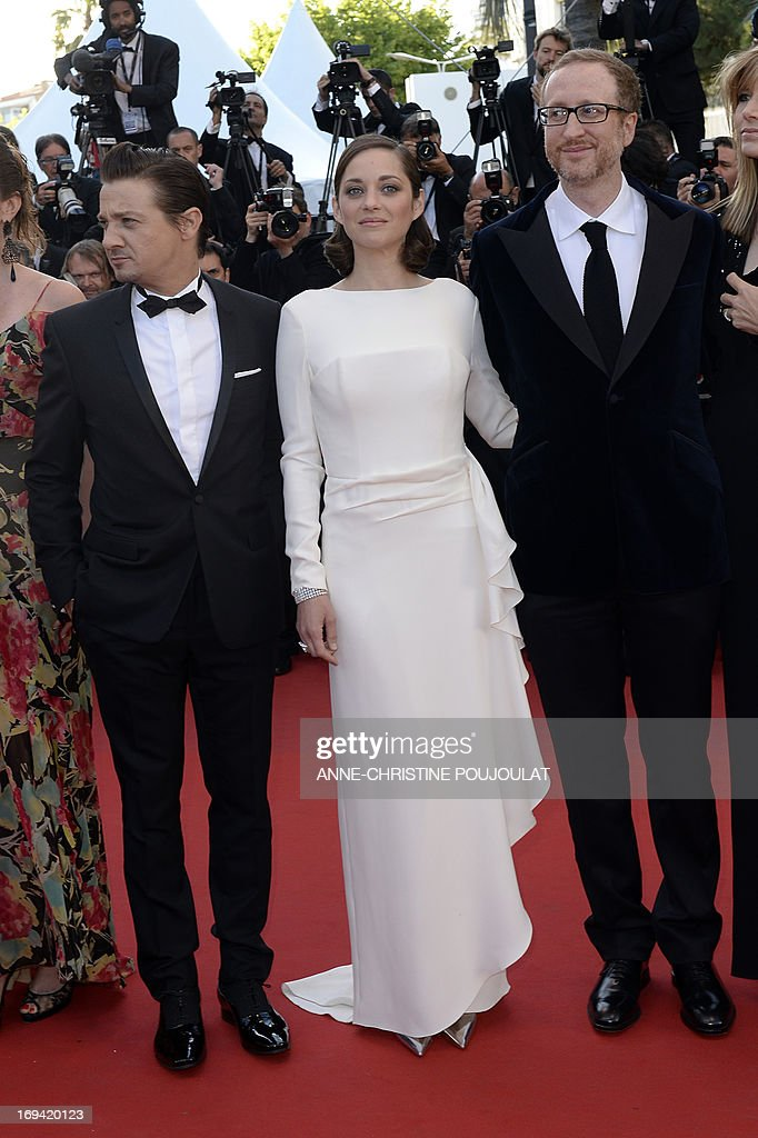 US actor Jeremy Renner, French actress Marion Cotillard and US director James Gray pose on May 24, 2013 as they arrive for the screening of the film 'The Immigrant' presented in Competition at the 66th edition of the Cannes Film Festival in Cannes. Cannes, one of the world's top film festivals, opened on May 15 and will climax on May 26 with awards selected by a jury headed this year by Hollywood legend Steven Spielberg.