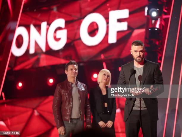 Actor Jeremy Renner listens as musician Justin Timberlake accepts the Song of the Year award for 'Can't Stop the Feeling' onstage at the 2017...