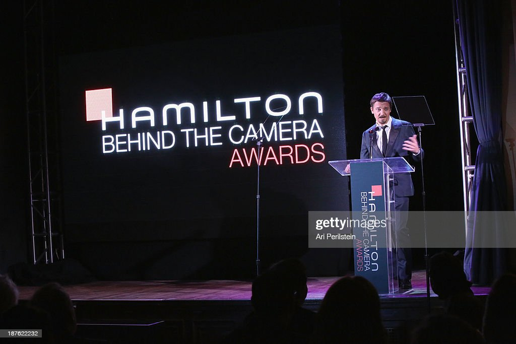 Actor <a gi-track='captionPersonalityLinkClicked' href=/galleries/search?phrase=Jeremy+Renner&family=editorial&specificpeople=708701 ng-click='$event.stopPropagation()'>Jeremy Renner</a> speaks onstage during Hamilton and Los Angeles Confidential Magazine's announcement of the 7th Annual Hamilton Behind The Camera Awards at The Wilshire Ebell Theatre on November 10, 2013 in Los Angeles, California.