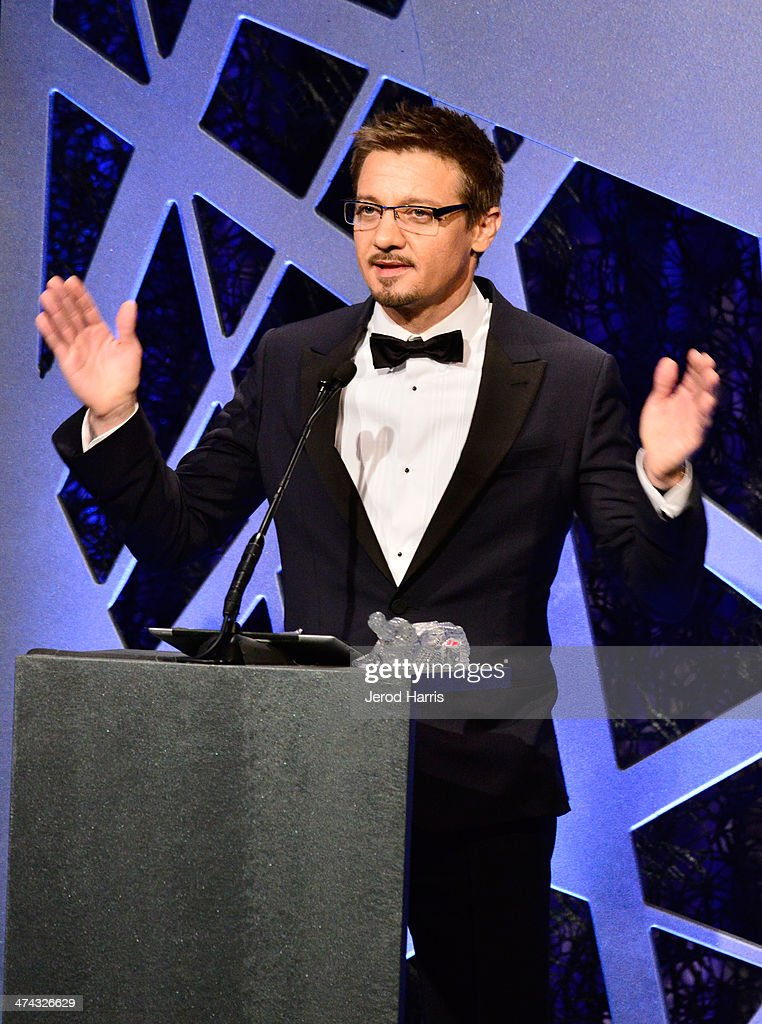 Actor Jeremy Renner speaks onstage during the 16th Costume Designers Guild Awards with presenting sponsor Lacoste at The Beverly Hilton Hotel on February 22, 2014 in Beverly Hills, California.