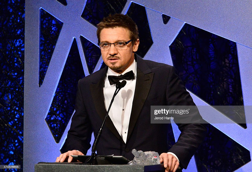 Actor <a gi-track='captionPersonalityLinkClicked' href=/galleries/search?phrase=Jeremy+Renner&family=editorial&specificpeople=708701 ng-click='$event.stopPropagation()'>Jeremy Renner</a> speaks onstage during the 16th Costume Designers Guild Awards with presenting sponsor Lacoste at The Beverly Hilton Hotel on February 22, 2014 in Beverly Hills, California.