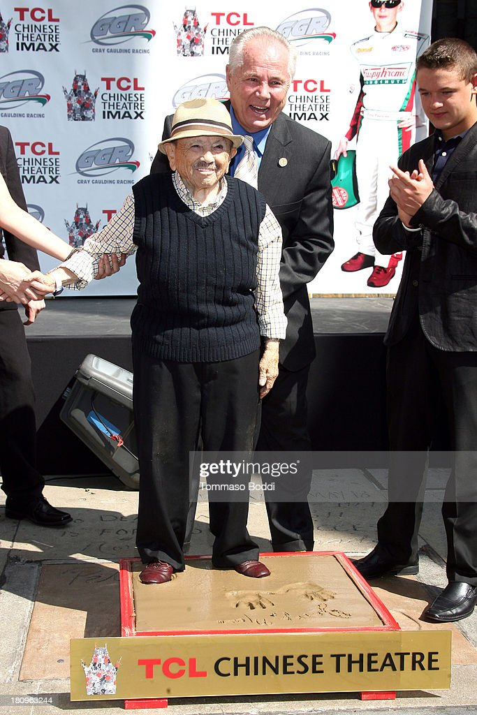 Actor <a gi-track='captionPersonalityLinkClicked' href=/galleries/search?phrase=Jerry+Maren&family=editorial&specificpeople=3637561 ng-click='$event.stopPropagation()'>Jerry Maren</a>, Councilman Tom Labonge and driver Gray Gauldin attend the handprint-footprint ceremony for 'The Lollipop Kid' last of the Munchkins from 'The Wizard Of Oz' the at TCL Chinese Theatre Imax on September 18, 2013 in Hollywood, California.
