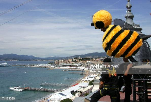 Actor Jerry Seinfeld slides down from the Carlton Hotel dressed as a bee to promote the film 'Bee Movie' during the 60th International Cannes Film...