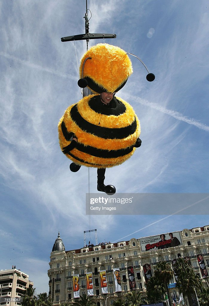 Actor Jerry Seinfeld slides down on a wire from the Carlton Hotel dressed as a bee to promote the film 'Bee Movie' during the 60th International...