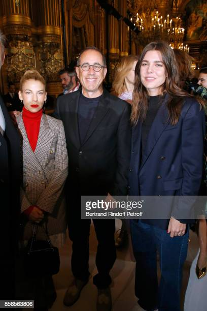 Actor Jerry Seinfeld standing between his wife Jessica and Charlotte Casiraghi attend the Stella McCartney show as part of the Paris Fashion Week...