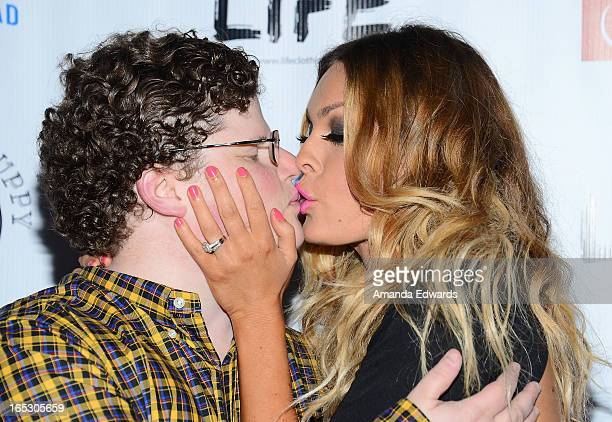 Actor Jesse Heiman and model Jasmine Dustin arrive at the No Kill LA Charity Event at Fred Segal on April 2 2013 in West Hollywood California