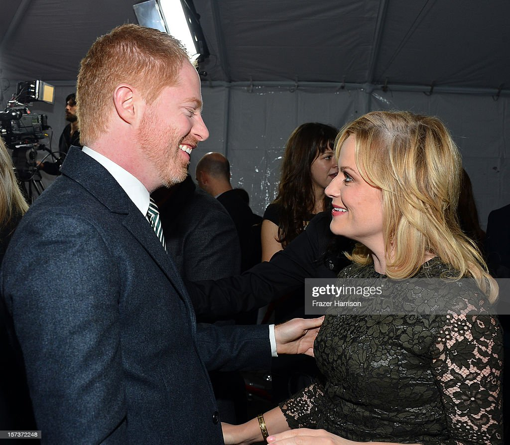 Actor <a gi-track='captionPersonalityLinkClicked' href=/galleries/search?phrase=Jesse+Tyler+Ferguson&family=editorial&specificpeople=633114 ng-click='$event.stopPropagation()'>Jesse Tyler Ferguson</a> (L) and actress <a gi-track='captionPersonalityLinkClicked' href=/galleries/search?phrase=Amy+Poehler&family=editorial&specificpeople=228430 ng-click='$event.stopPropagation()'>Amy Poehler</a> arrive at 'Trevor Live' honoring Katy Perry and Audi of America for The Trevor Project held at The Hollywood Palladium on December 2, 2012 in Los Angeles, California.