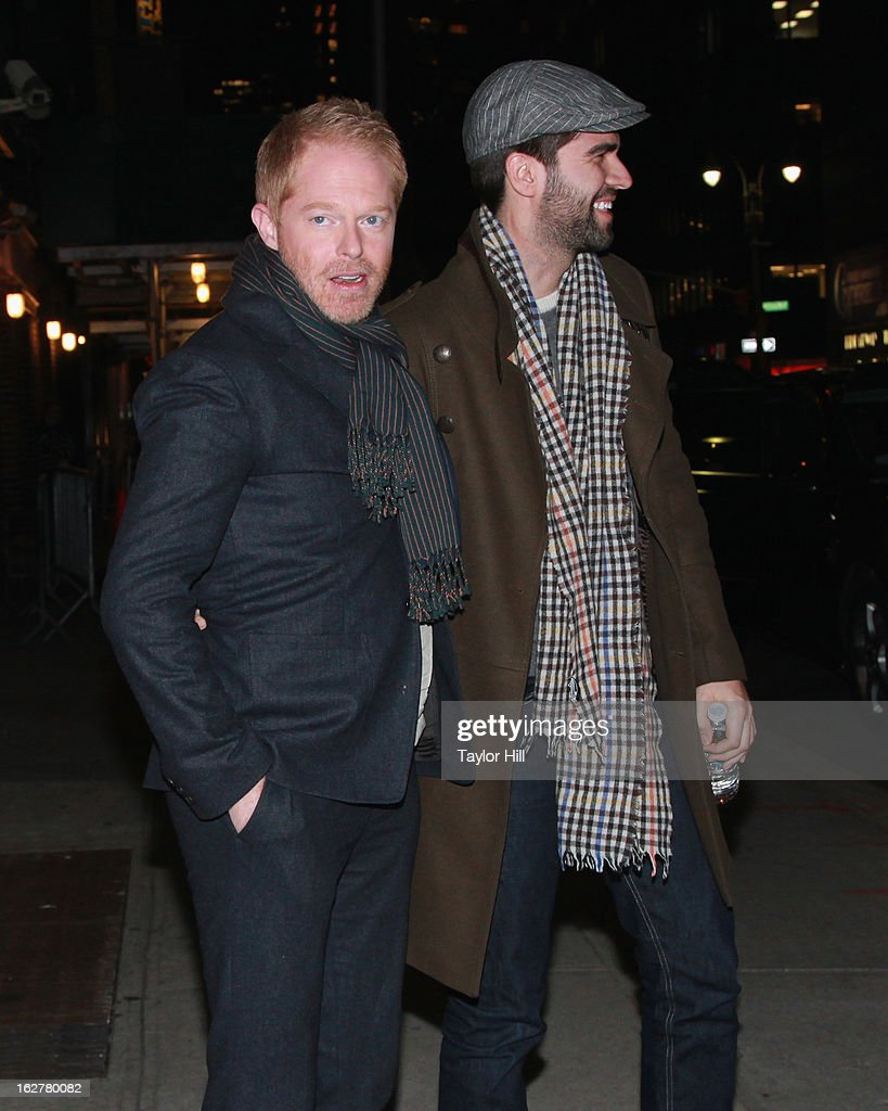 Actor Jesse Tyler Ferguson and fiancee Justin Mikita depart 'Late Show with David Letterman' at Ed Sullivan Theater on February 26, 2013 in New York City.