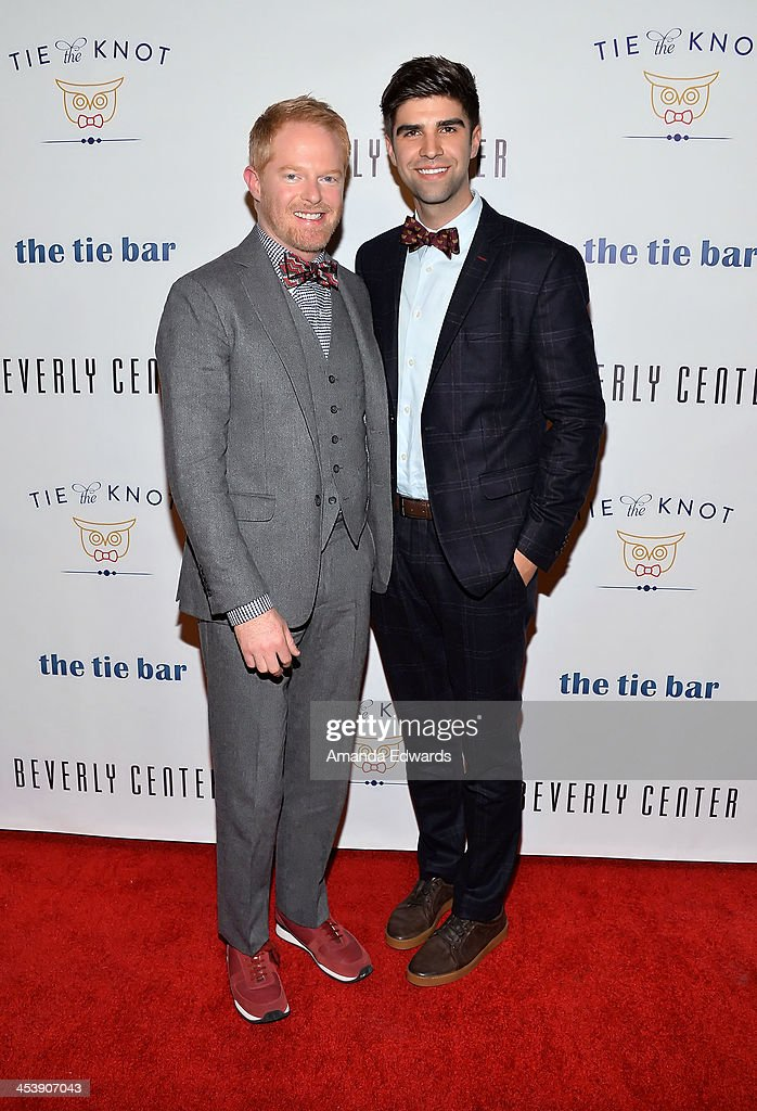 Actor <a gi-track='captionPersonalityLinkClicked' href=/galleries/search?phrase=Jesse+Tyler+Ferguson&family=editorial&specificpeople=633114 ng-click='$event.stopPropagation()'>Jesse Tyler Ferguson</a> (L) and his husband <a gi-track='captionPersonalityLinkClicked' href=/galleries/search?phrase=Justin+Mikita&family=editorial&specificpeople=7458663 ng-click='$event.stopPropagation()'>Justin Mikita</a> arrive at the 'Tie The Knot' grand store opening at The Beverly Center on December 5, 2013 in Los Angeles, California.