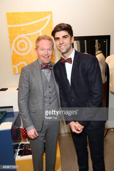 Actor Jesse Tyler Ferguson and husband Justin Mikita attend Tie The Knot PopUp Store at The Beverly Center on December 5 2013 in Los Angeles...