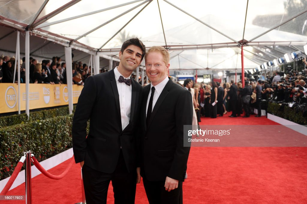 Actor Jesse Tyler Ferguson (R) and Justin Mikita attend the 19th Annual Screen Actors Guild Awards at The Shrine Auditorium on January 27, 2013 in Los Angeles, California. (Photo by Stefanie Keenan/WireImage) 23116_025_0972.JPG